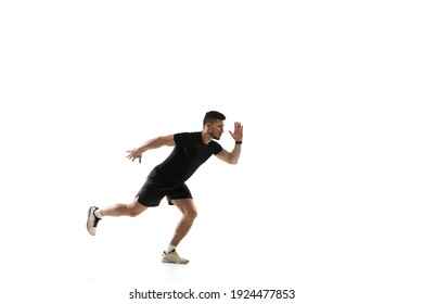 Starting. Caucasian professional sportsman training isolated on white studio background. Muscular, sportive man practicing. Copyspace. Concept of action, motion, youth, healthy lifestyle.