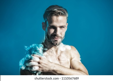 Starting day. Natural athlete showering. Skin care, body care, health care, spa, beauty, people concept - sexy macho, unshaven man, muscular attractive bearded hipster in boxer shorts washes in shower