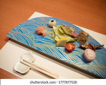 Starting dinner with Creative decorated japanese kaiseki seafood appetizers with fish, sashimi, shrimp roll and jelly on a nice plate