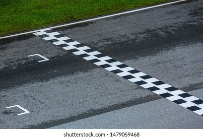 Starting and finishing grid asphalt, race track detail. Motorsports racing circuit close up.