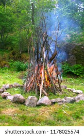Starting a fire at the fireplace in peaceful forest.