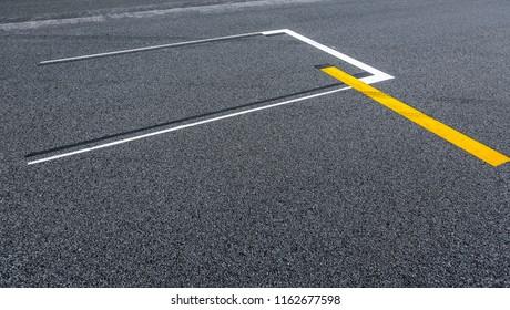 Starting grid asphalt, race track detail. Motorsports racing circuit close up.