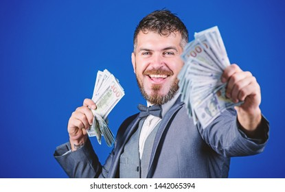 Starting his own business. Rich businessman with us dollars banknotes. Bearded man holding cash money. Making money with his own business. Currency broker with bundle of money. Business startup loan.