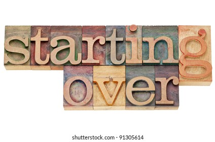 starting over - isolated text in vintage wood letterpress printing blocks stained by color inks
