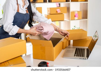 Starting small businesses SME owners female entrepreneurs Video calling with customers to receive and review orders online to prepare to pack boxes, sell to customers, online sme business ideas.