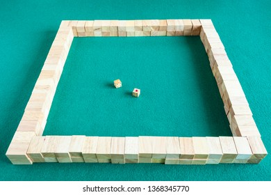 starting walls of mahjong, tile-based chinese strategy board game on green baize table