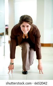 starting your own business - woman in an office ready to go