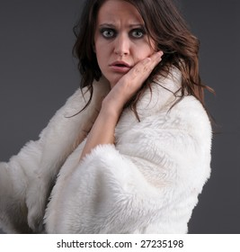 startled woman in white coat