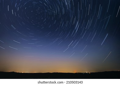 Startrail landscape of moving stars during the night of the Perseid meteor shower