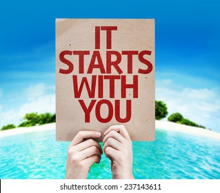 It Starts With You card with a beach on background