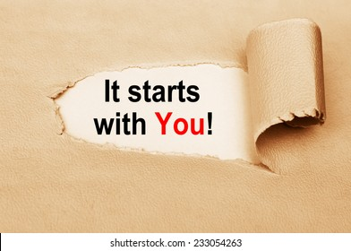 It Starts With You written behind a torn paper