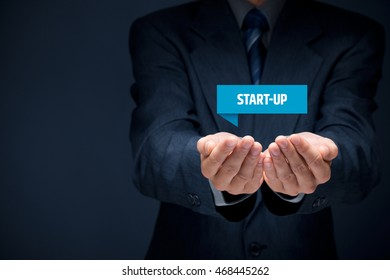 Start-up business concept. Businessman hold virtual label with text start-up.