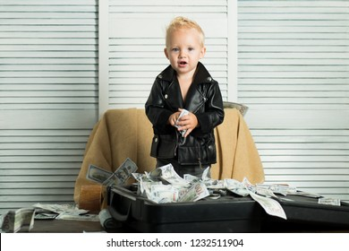 Startup business costs. Boy child with money case. Little entrepreneur work in office. Little boy count money in cash. Small child do business accounting in startup company. Money circulation.