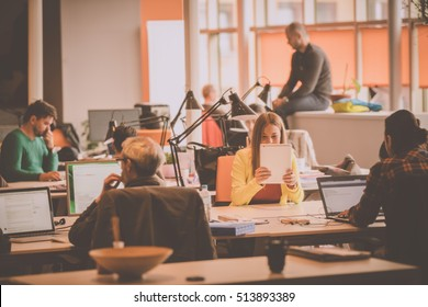 startup business people group working everyday job at modern coworking space