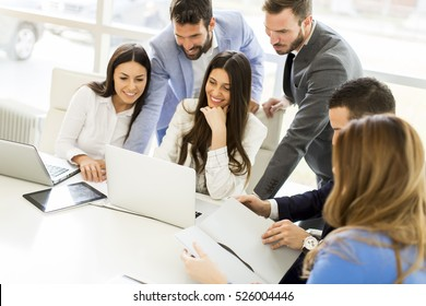 Startup business team on meeting in modern bright office interior and working on laptop