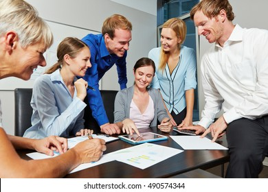 Start-up business team working with tablet computer in the office