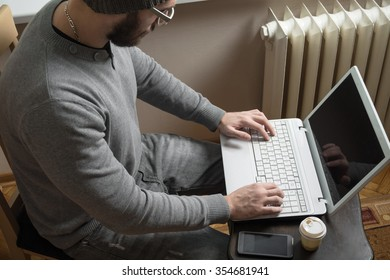 Start-up businessman working on laptop