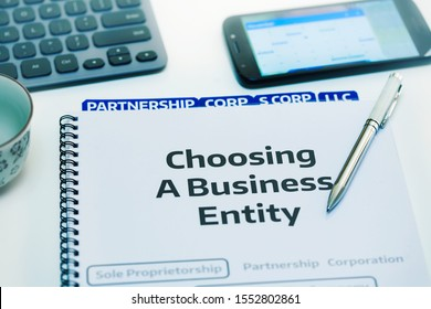 Startup company desk reviewing the different types of business entities.