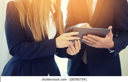 Startup Diversity Teamwork Brainstorming Meeting Concept.Business Team Coworker  Sharing  business plan on tablets Screen.People Working Planning Start Up.Group Young Man Women Looking Business Report