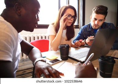 Startup Diversity Teamwork Brainstorming Meeting Concept.Business Team. People Working Planning Start Up.Group Young Hipsters Discussing Cafe