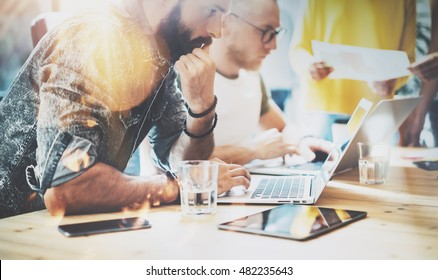 Startup Diversity Teamwork Brainstorming Meeting Concept.Business Team Coworkers Analyze Finance Report Laptop.People Working Start Up Process.Group Young Hipsters Discussing Office Blurred Background
