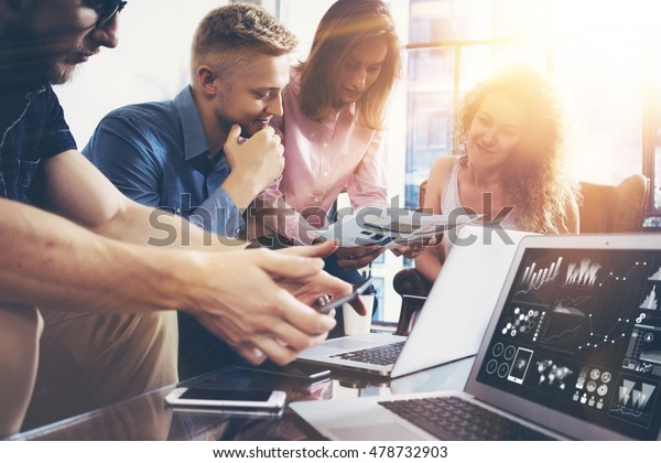 Startup Diversity Teamwork Brainstorming Meeting Concept.Business Team Coworker Global Sharing Economy Laptop Graph Screen.People Working Planning Start Up.Group Young Man Women Looking Report Office