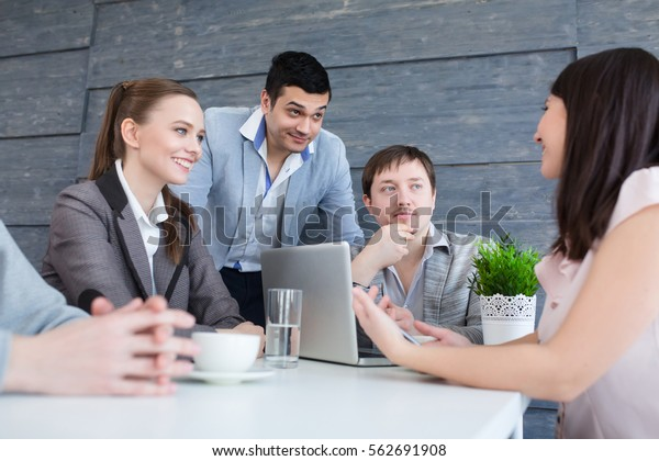 Startup diversity teamwork brainstorming meeting concept. Business young multiethnic team working and planning Start Up in modern office.