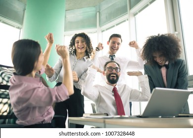 Startup diversity teamwork. Managers are happy after agreement signing.