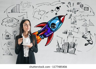 Startup and leadership concept. Portrait of young european businesswoman with creative business sketch