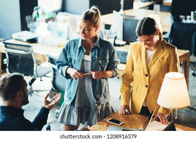 Startup and millenial business concept. Two cheerful women discussing projects with manager in office
