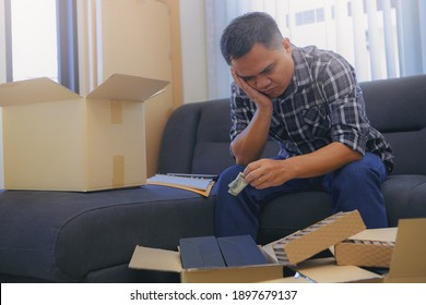 Startup on-line business entrepreneur SME, handsome man seriously and stress about his business result at home office. SME e-commerce telemarketing concept.