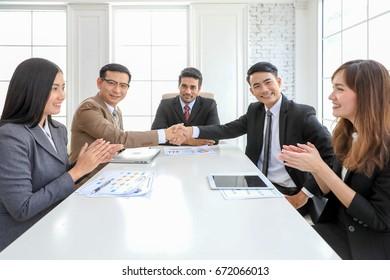Startup project business meeting teamwork brainstorm concept. Image businessmans handshake. Successful businessmen handshaking after good deal. Horizontal, blurred background.
