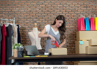 Startup small business owner working at home, women sealing cardboard box with adhesive tape, Online shopping business, ecommerce and delivery to customer concept
