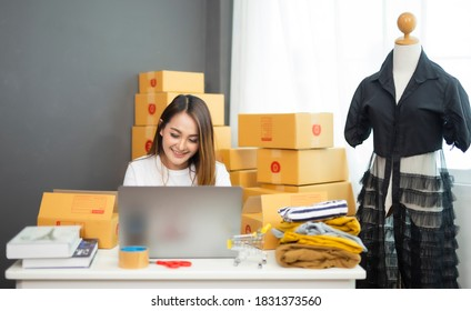 Startup small businessnworking with computer at workplace. Freelance woman seller check product order.market place.Online selling.Online Shopping. E-commerce.