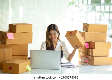 Startup small businessnworking with computer at workplace. Freelance woman seller check product order.market place.Online selling.Online Shopping. SME,E-commerce.