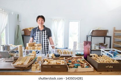 Startup successful Asia sme small business entrepreneur owner asian man standing in handmade organic oil spa soap shop. Portrait of asian man successful seller owner environment friendly concept