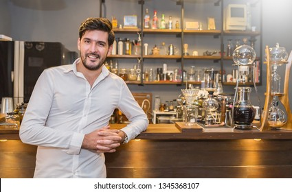 Startup successful small business entrepreneur owner man standing in his coffee shop or restaurant. Portrait of young caucasian man successful barista cafe local owner concept