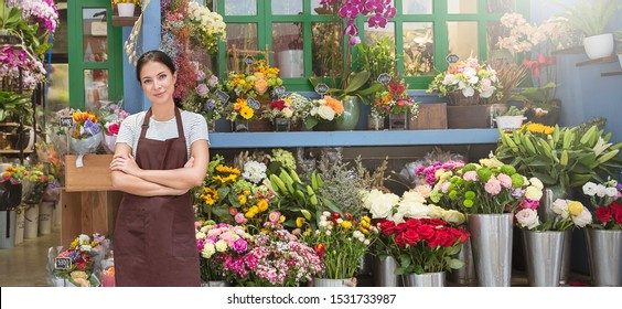 Startup successful sme small business entrepreneur owner asian woman standing with flowers at florist shop service job. Portrait of caucasian girl successful owner environment friendly concept banner