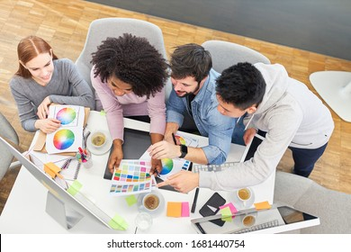 Start-up team brainstorming about color design in the office of a design agency