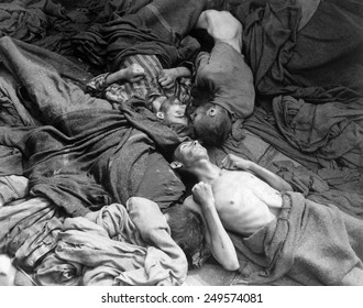 Starved bodies of prisoners in a freight car at Dachau on April 30, 1945. U.S. troops found fifty such cars with 2,500 bodies who had died enroute to Dachau from concentration camps.