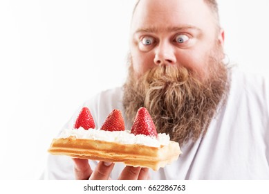 Starving fat man looking at dessert with shock