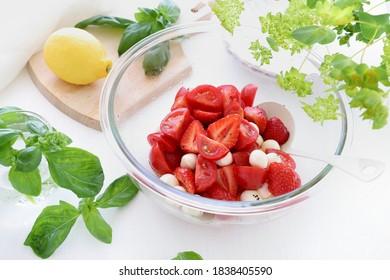 Starwberry and tomato caprese salad in glasses