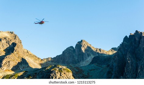 Stary Smokovec, Slovakia - October 12, 2018: The helicopter OM-Eva (Type Mil Mi-8T) returns after shelter deliveries to the mountains. Tatra Mountains.