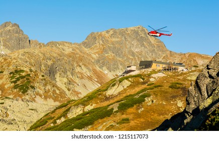 Stary Smokovec, Slovakia - October 12, 2018: Helicopter OM- EVA (Type Mil Mi-8T) above the shelter (Zbojnicka chata) in the mountains. Tatra Mountains.