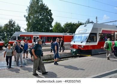 STARY SMOKOVEC, SLOVAKIA - SEPTEMBER 14, 2016: Rush hour at railway station Stary Smokovec in High Tatras. People travelling to Stary Smokovec to begin hiking in High Tatras.