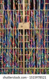 STATE OF BAHIA, BRAZIL - SEPTEMBER 25, 2019: Bonfim ribbons tied on steel door
