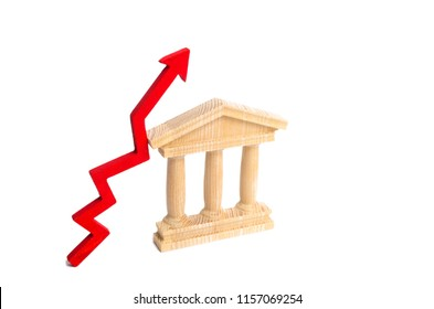 State building and red arrow up. The concept of improving the efficiency of the state, economic growth and prosperity. Distrust of the government. Growth of the bank's capital and welfare