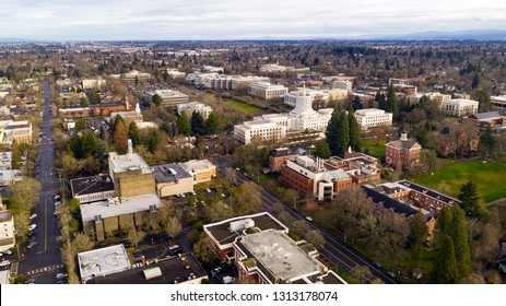 The state capital building adorned with the Oregon Pioneer with Willamette University grounds visable
