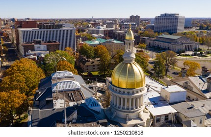 The state capital dome reflects sunlight late afternoon in downtown Trenton New Jersey