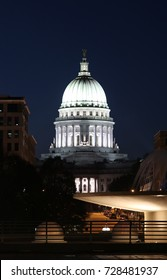 State capitol building dome. Wisconsin State Capitol building, National Historic Landmark. Madison, Wisconsin, USA. Night scene. View from Monona terrace balcony, vertical composition.